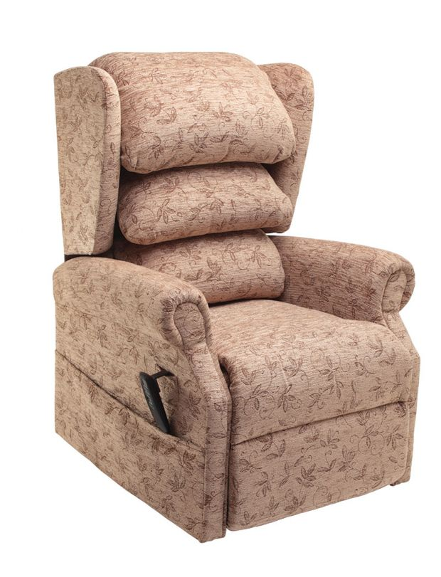 Here we have the All Terrain Mobility Tilt In Space Rise & recline chair in spray - this is comfortable arm chair-style rise & recline chair with a waterfall back, electric hand control in a beige fabric with a leafy pattern.
